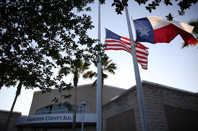 <p>Flags fly at half mast outside the Galveston County Jail in Galveston, Texas, U.S., where suspect Dimitrios Pagourtzis was charged in connection with a shooting that left several people dead at Santa Fe High School in Santa Fe, Texas, May 18, 2018. (Photo: Pu Ying Huang/Reuters) </p>