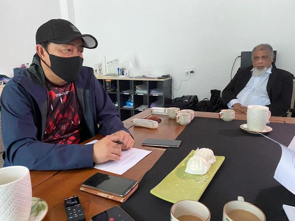 Philip Among (left) with lawyer Marcel Jude Joseph. — Picture by Julia Chan