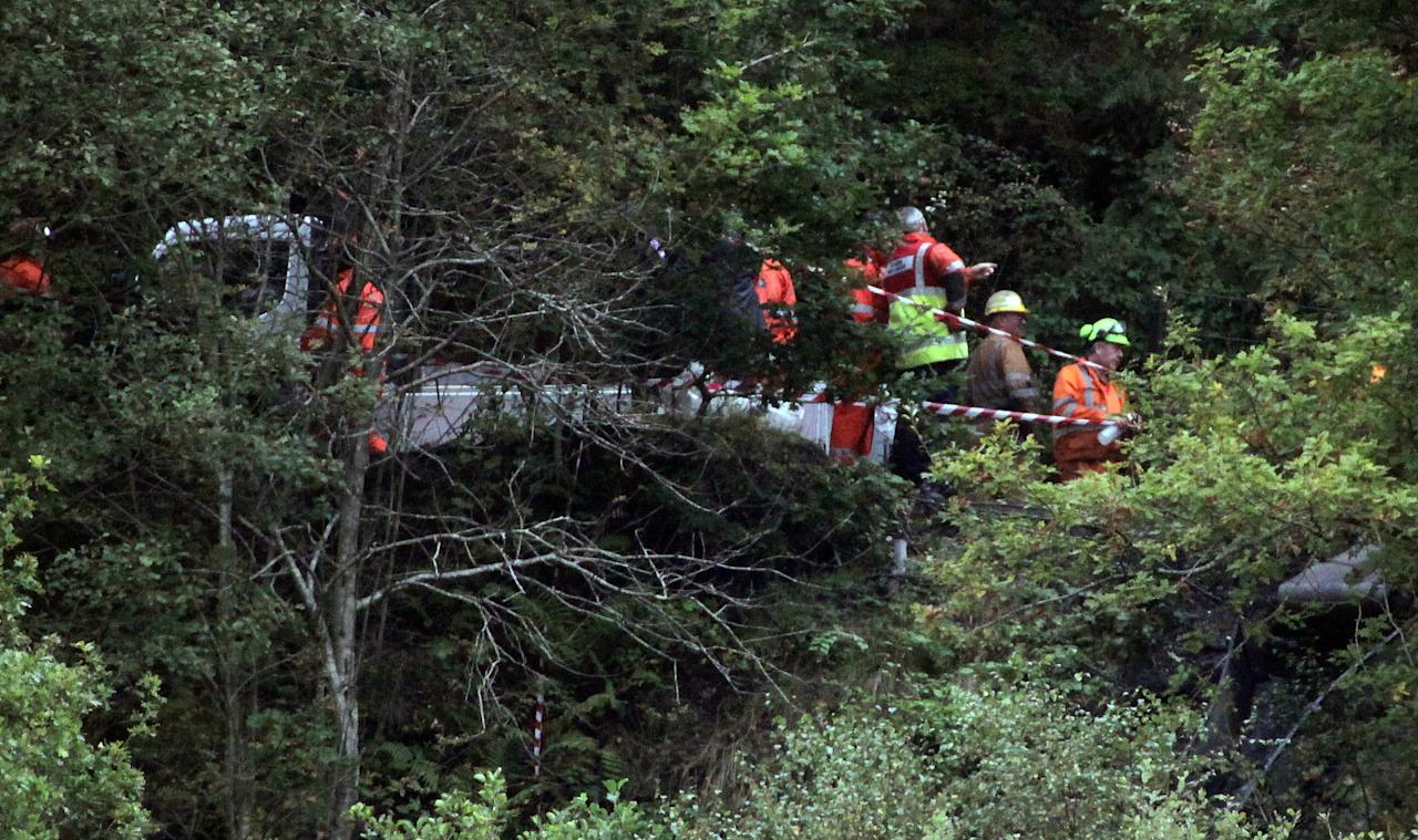 SWANSEA, WALES - SEPTEMBER 15:  Rescue workers try to rescue four Welsh miners that have been trapped 300ft underground after a coal mine tunnel collapsed and flooded near the village of Cilybebyll in the Swansea Valley, on September 15, 2011 near Swansea, Wales. Three men were hoisted to the surface earlier, while another four workers remain below the rubble with the emergency services currently working to reach them. (Photo by Matt Cardy/Getty Images)