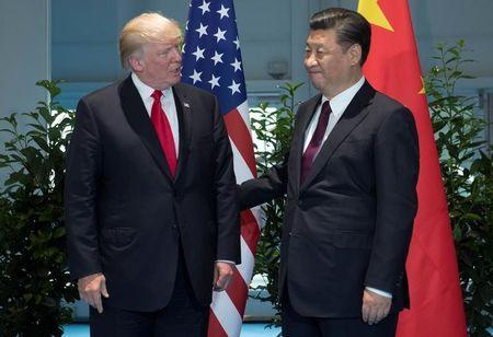 FILE PHOTO - U.S. President Donald Trump and Chinese President Xi Jinping (R) meet on the sidelines of the G20 Summit in Hamburg, Germany, July 8, 2017. REUTERS/Saul Loeb, Pool