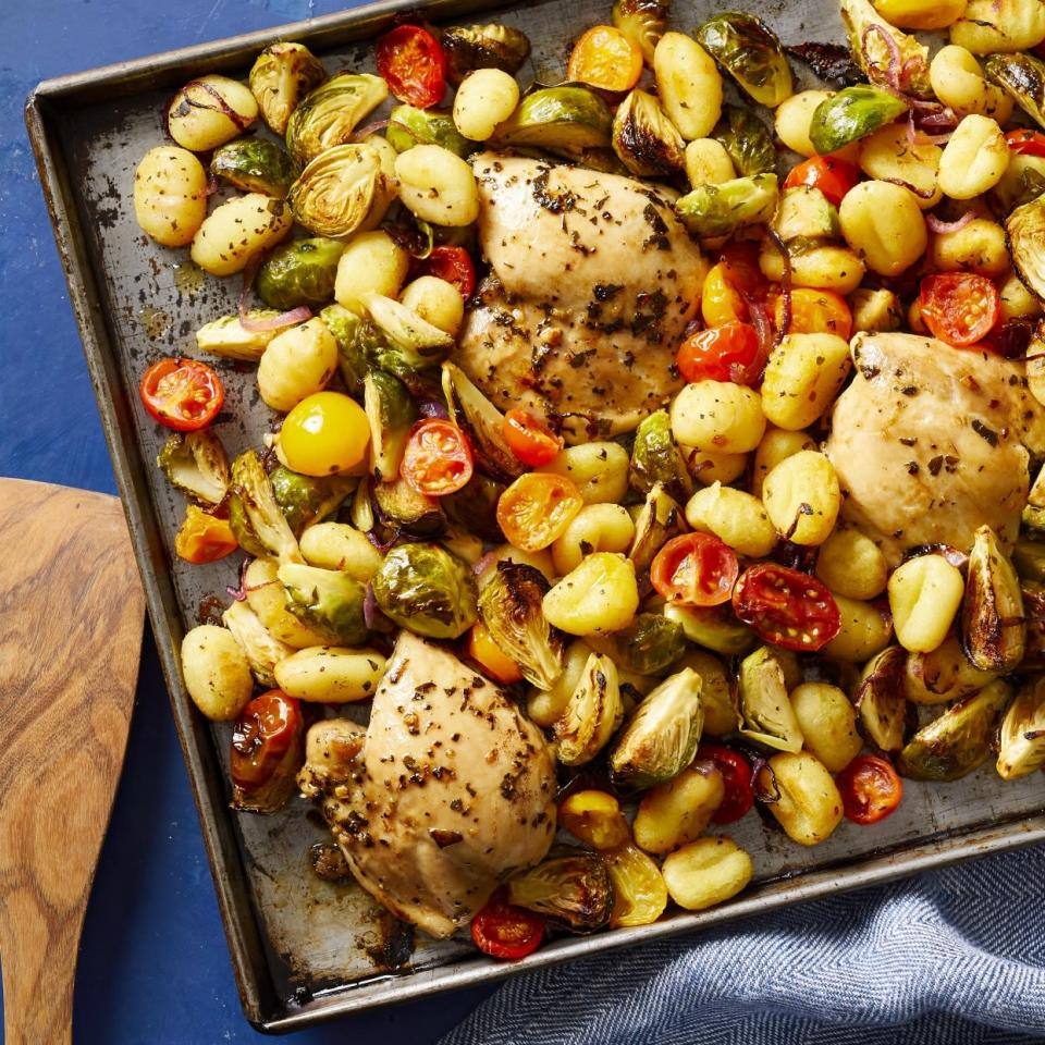"<p>In this healthy dinner recipe, chicken thighs, Brussels sprouts, cherry tomatoes and packaged gnocchi are all roasted on the same sheet pan for a complete meal that couldn't be easier to make. And though it's simple, this dish gets tons of flavor from Mediterranean seasonings, including garlic, oregano and red-wine vinegar. It all adds up to a dish that's ready to go into heavy weeknight rotation in your house. <a href=""http://www.eatingwell.com/recipe/276146/sheet-pan-mediterranean-chicken-brussels-sprouts-gnocchi/"" rel=""nofollow noopener"" target=""_blank"" data-ylk=""slk:View recipe"" class=""link rapid-noclick-resp""> View recipe </a></p>"