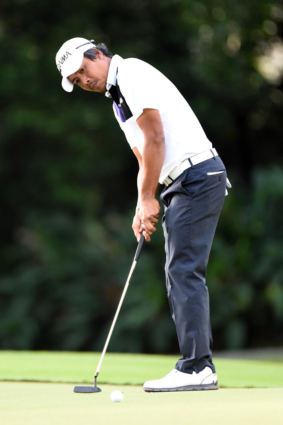 KUALA LUMPUR, MALAYSIA - FEBRUARY 18:  Juvic Pagunsan of the Philippines putts on the 2nd hole during the first round of the Maybank Championship Malaysia at Royal Selangor Golf Club on February 18, 2016 in Kuala Lumpur, Malaysia.  (Photo by Stanley Chou/Getty Images)
