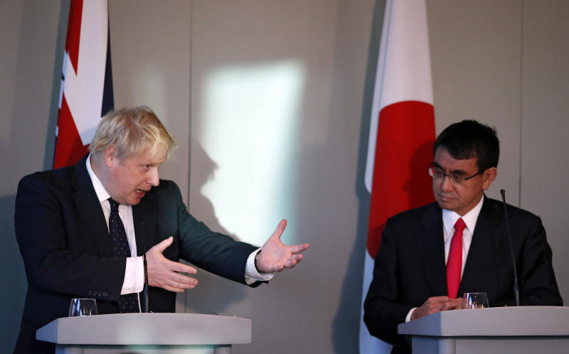 Britain's Foreign Secretary Boris Johnson, left, speaks alongside his Japanese counterpart Foreign Minister Taro Kono during a press conference at the National Maritime Museum in Greenwich, London, Thursday, Dec. 14, 2017. (AP Photo/Kirsty Wigglesworth, pool)