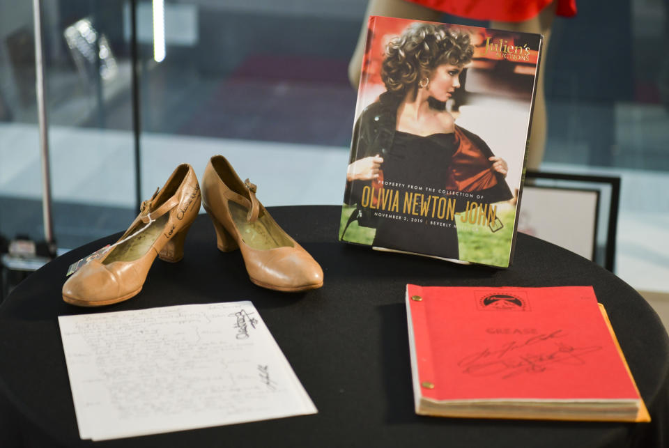 """BEVERLY HILLS, CALIFORNIA - OCTOBER 29: Autographed """"Grease"""" script and shoes at the VIP reception for upcoming """"Property of Olivia Newton-John Auction Event at Julien's Auctions on October 29, 2019 in Beverly Hills, California. (Photo by Rodin Eckenroth/Getty Images)"""