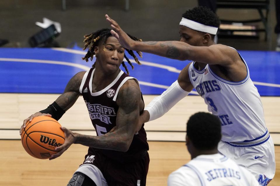 Mississippi State guard Deivon Smith (5) looks to make a pass as Memphis guard Landers Nolley II (3) defends in the second half of an NCAA college basketball championship game in the NIT, Sunday, March 28, 2021, in Frisco, Texas. (AP Photo/Tony Gutierrez)