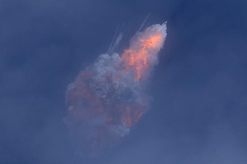 A SpaceX Falcon 9 rocket engine self-destructs after jettisoning the Crew Dragon astronaut capsule during an in-flight abort test after lift of from the Kennedy Space Center in Cape Canaveral