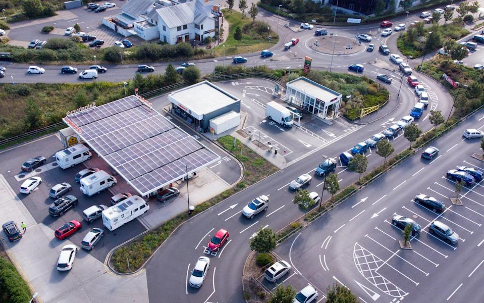 Vehicles queue for fuel at a Sainsbury's petrol station on September 24, 2021 in Weymouth, England - Finnbarr Webster /Getty Images Europe