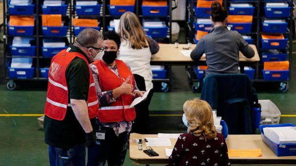 PHOTO: Election workers check mail-in and absentee ballots for the 2020 General Election  at West Chester University, Nov. 3, 2020, in West Chester, Pa. (Matt Slocum/AP)