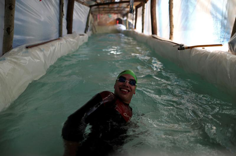 Sebastian Galleguillo, a paralympic swimmer who suffers from hearing loss, trains in the swimming pool his family built for him, during the outbreak of the coronavirus disease (COVID-19), in Florencio Varela, on the outskirts of Buenos Aires, Argentina July 13, 2020. Picture taken July 13, 2020. REUTERS/Agustin Marcarian
