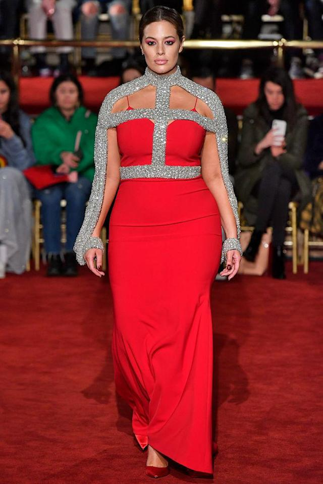 <p>Model Ashley Graham wears a crimson-and-silver-crystal gown at the Christian Siriano FW18 show. (Photo: Getty) </p>