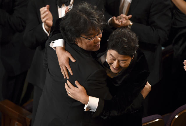 Bong Joon-ho and Song Kang-ho celebrate at the Oscars before going on stage to accept the award for best picture for <em>Parasite</em>. (AP Photo/Chris Pizzello)