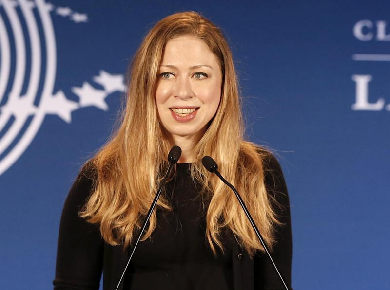 """FILE - In a Dec. 9, 2013, file photo Chelsea Clinton speaks in Rio de Janeiro, Brazil. Chelsea Clinton says she and her husband are expecting their first child later this year. The daughter of former President Bill Clinton and former Secretary of State Hillary Rodham Clinton announced at a Clinton Foundation event in New York that she and her husband, Marc Mezvinsky, are """"very excited"""" to be having their first child later this year. (AP Photo/Silvia Izquierdo, file)"""