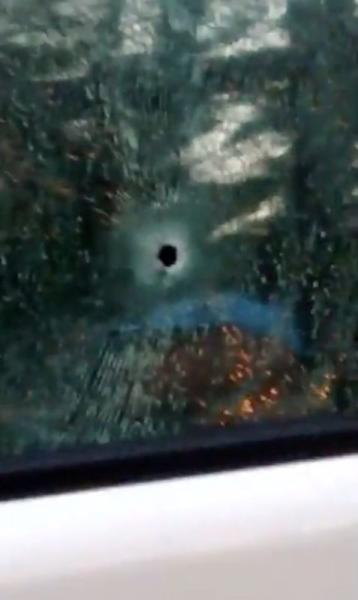 A bullet hole is seen on the window of a car after a shooting rampage in the city of Nakhon Ratchasima