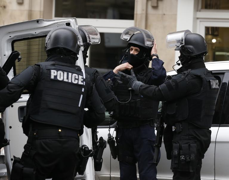Members of the French national police intervention group (BRI) arrive at the scene where a female police officer was shot dead in Montrouge, a southern suburb of Paris