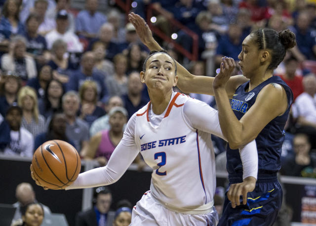 Boise State forward Shalen Shaw (2) looks to pass over Nevada forward Terae Briggs (11) during first quarter of an NCAA college basketball game in the championship of the Mountain West Conference tournament Friday, March 9, 2018, in Las Vegas. (AP Photo/L.E. Baskow)