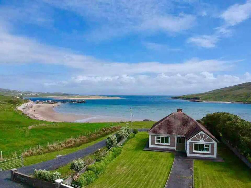 """<p>Set on beautiful Achill Island, this Airbnb is ideal for a family or romantic getaway. You'll wake up to unobstructed, breathtaking views of Clew Bay, Croagh Patrick and Cloghmore Beach, and enjoy private access to the idyllic beach, located only 50 metres from the back door. Inside, there's space, privacy and warmth to create new memories, with all the essentials you need for an island escape.</p><p><strong>Sleeps:</strong> 7</p><p><a class=""""link rapid-noclick-resp"""" href=""""https://airbnb.pvxt.net/n12qo7"""" rel=""""nofollow noopener"""" target=""""_blank"""" data-ylk=""""slk:SEE INSIDE"""">SEE INSIDE</a></p>"""