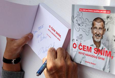 The leader of ANO party Andrej Babis signs his books during an election campaign rally in Prague, Czech Republic September 28, 2017. REUTERS/David W Cerny