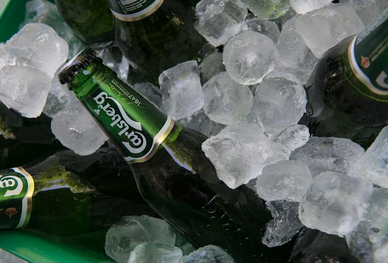 May 1, 2016: Nicosia, Cyprus - May 7 2016: Small green bottles of famous Carlsberg beer on ice ready to be served.