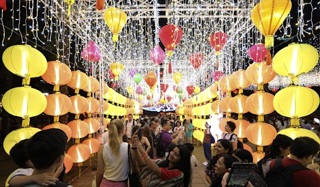 Visitors enjoying the Mid-Autumn Festival lantern show at Victoria Park in Causeway Bay. Photo: Felix Wong
