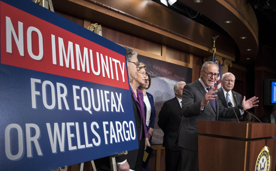Senate Minority Leader Chuck Schumer, D-N.Y. and other Senate Democrats, from left, Sen. Al Franken, D-Minn., Sen. Elizabeth Warren, D-Mass., Sen. Catherine Cortez Masto, D-Nev., Sen. Jack Reed, D-R.I., and Sen. Patrick Leahy, D-Vt., discuss consumer protections in the wake of a massive data breach at Equifax and a scandal at Wells Fargo, at the Capitol in Washington, Wednesday, Sept. 27, 2017. Executives for both Wells Fargo and Equifax will testify in Senate committees next week. (AP Photo/J. Scott Applewhite)