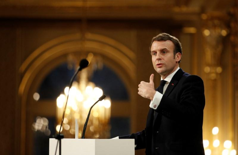 French President Emmanuel Macron delivers his New Year wishes to the press at the Elysee Palace in Paris