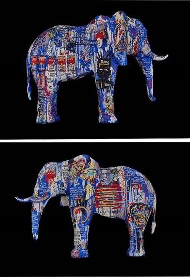 A sculpture of an elephant with pop art on either side.