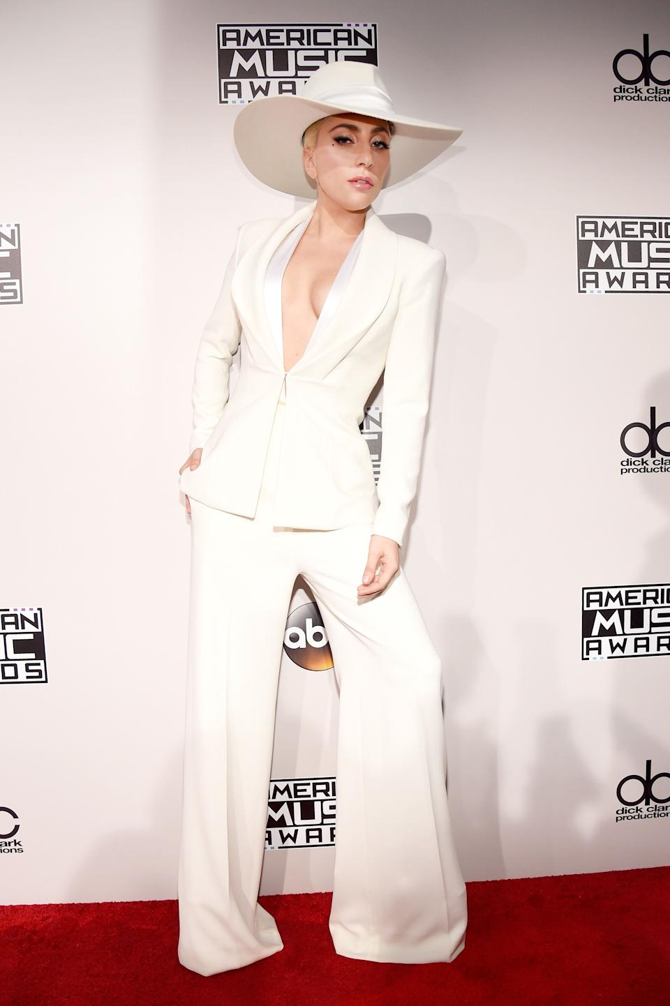 Gaga rocks a sleek white suit on the red carpet at the 2016 American Music Awards.