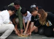 Student leaders install a plaque near the Grand Palace in Bangkok