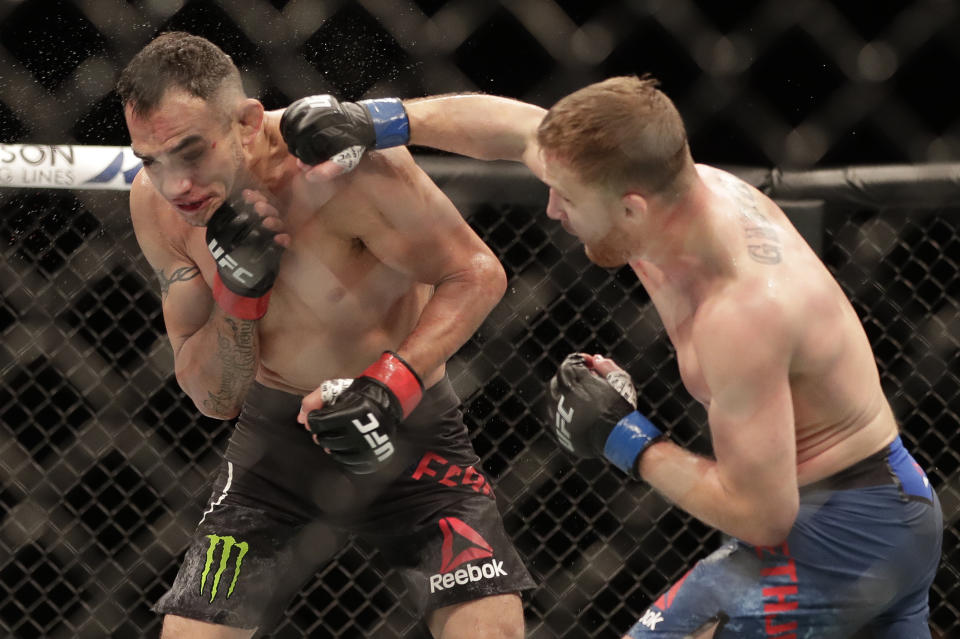 Justin Gaethje, right, punches Tony Ferguson during a UFC 249 mixed martial arts bout, Saturday, May 9, 2020, in Jacksonville, Fla. (AP Photo/John Raoux)