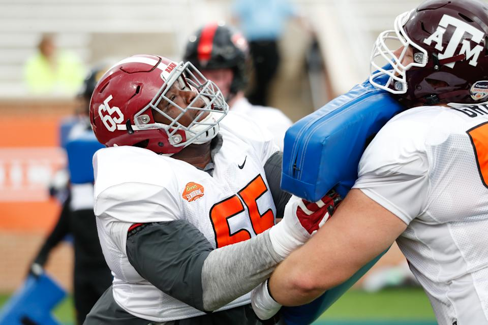 Alabama OG Deonte Brown (left) is the heaviest player at the 2021 Reeses Senior Bowl. (Photo by Senior Bowl/Collegiate Images/Getty Images)
