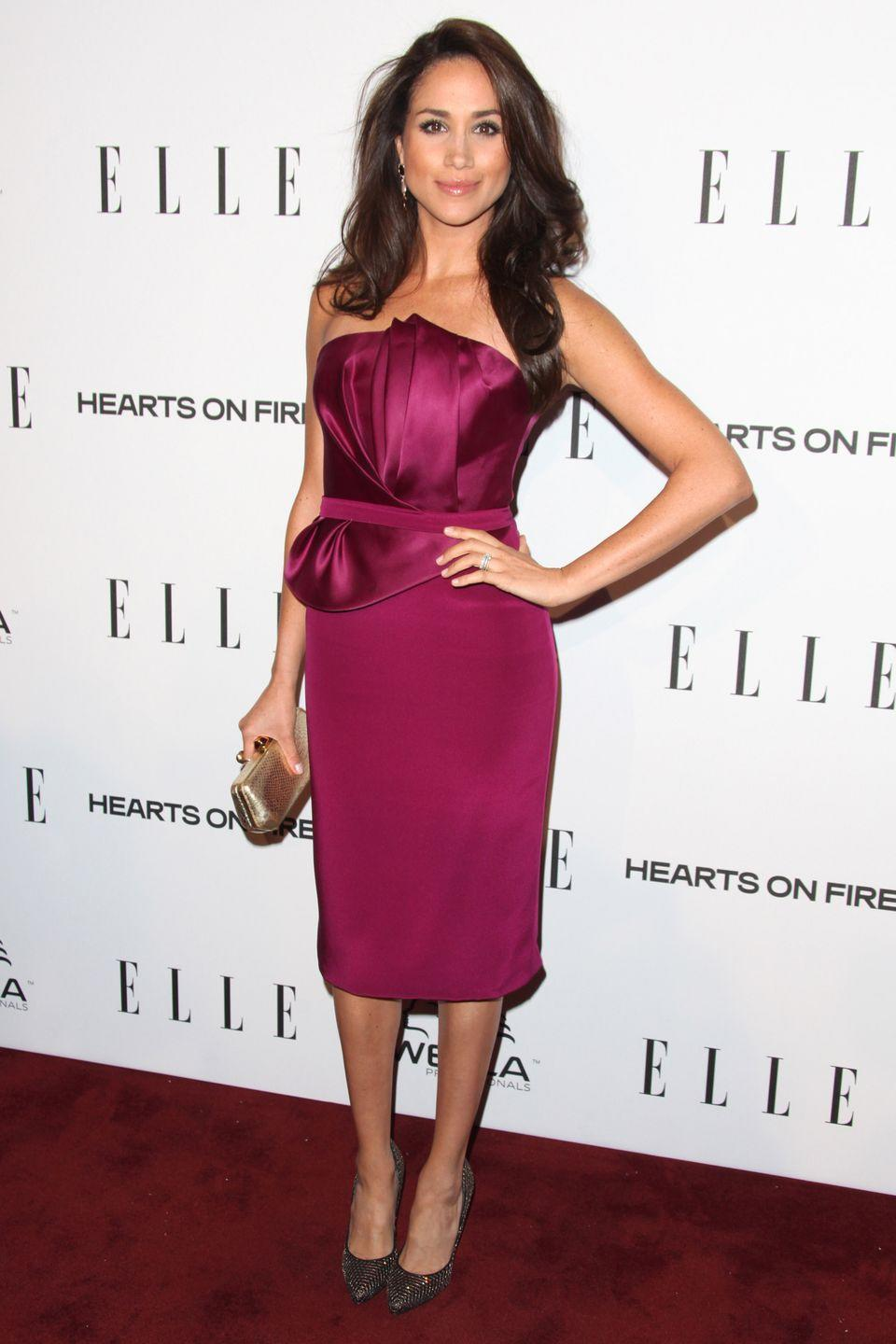<p>Wearing a raspberry pink Marchesa dress, Meghan Markle attends the ELLE Women in Television Celebration, January 2013</p>