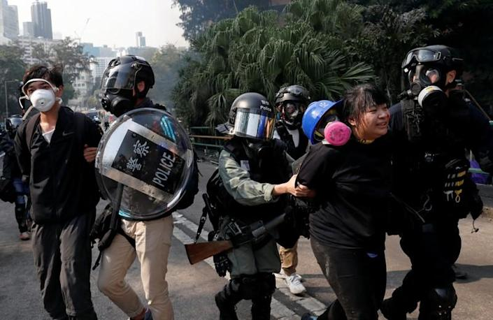 Protesters clash with riot police in the campus of Hong Kong Polytechnic University in Hong Kong