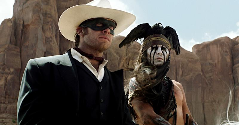 "This undated publicity photo from Disney/Bruckheimer Films, shows actors, Johnny Depp, left, as Tonto, a spirit warrior on a personal quest, who joins forces in a fight for justice with Armie Hammer, as John Reid, a lawman who has become a masked avenger in ""The Lone Ranger."" (AP Photo/Disney/Bruckheimer Films)"