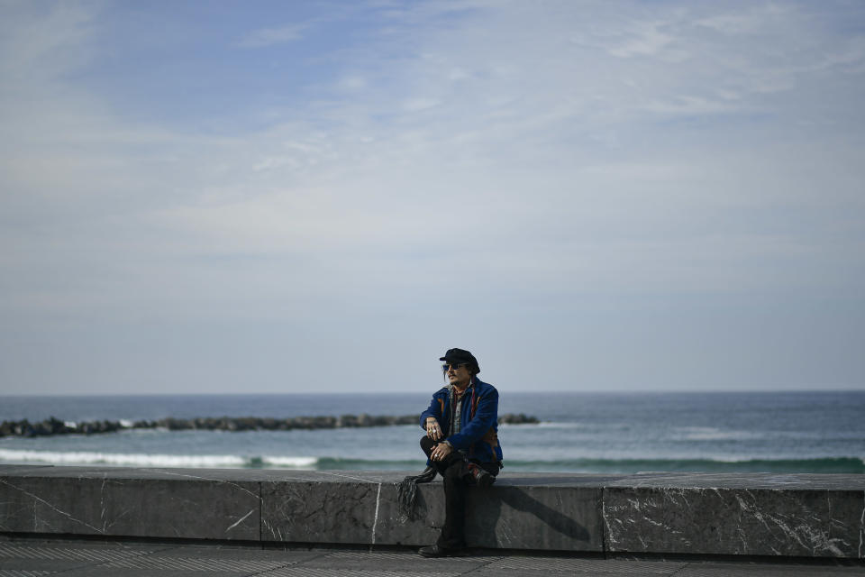 US actor Johny Deep poses on a wall during a photocall during the 69th San Sebastian Film Festival, in San Sebastian, northern Spain, Wednesday, Sept. 22, 2021. Johny Depp will be receiving on the night Donostia Award for his contribution to the cinema. (AP Photo/Alvaro Barrientos)