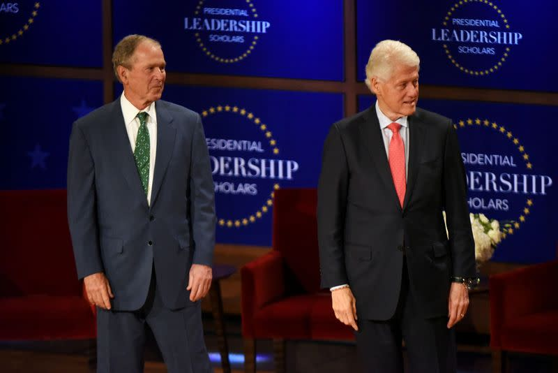 FILE PHOTO: Former U.S. Presidents George W. Bush and President Bill Clinton congratulate graduates of their Presidential Leadership Scholars program