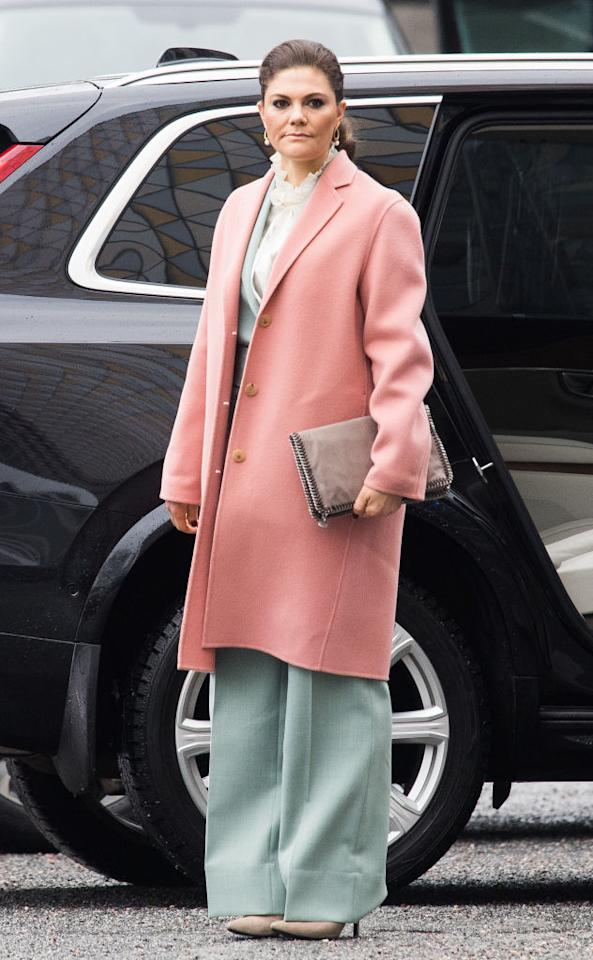 <p>Demonstrating how to sport Scandi minimalism with ease, Crown Princess Victoria donned sorbet hues in her favourite Acne coat and Rodebjer two-piece suit for day two. <em>[Photo: Getty]</em> </p>