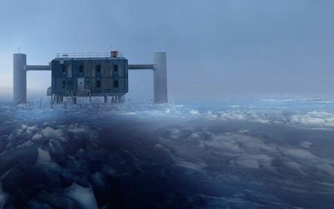 """The secrets of the origins of light are set to be unlocked by the discovery of an elusive """"ghost"""" particle a mile beneath Antarctica, scientists have announced. Astronomers have for the first time identified the source of a high-energy neutrino which shot through a solid ice laboratory at the South Pole last year in a """"triumph"""" that promises to revolutionise understanding of fundamental physics. Neutrinos are virtually massless, subatomic particles which race across the universe, passing unnoticed through planets and stars. Despite their abundance - hundreds of billions pass through each human every second - they have so far proved impossible to detect because they interact with matter so rarely. However, the detection of a neutrino on September 22 2017 has since enabled scientists to identify its point of origin using a complex network of ground and space-based radiation telescopes. The international team traced the particle's provenance to a flaring galaxy, or """"blazar"""", with a supermassive black hole at its heart four billion light years away. Because the neutrino comes from such a powerful light-producing source, its discovery should allow scientists to begin investigating the precise mechanism through which light is formed. Published in the journal Science, the breakthrough is being hailed as equal in importance to the discovery of gravitational waves - """"ripples"""" in space-time - in 2015. Professor Paul O'Brien, who contributed to the studyatthe University of Leicester, said: """"This result will allow us to study the most distant, powerful energy sources in the universe in a completely new way. He added: """"This includes the energy that goes into making light."""" Together with gravitational waves, the awareness of high-energy neutrinos gives astronomers a third """"messenger"""" through which to understand space, having until recently relied mainly on visual observations. Professor O'Brien likened it to a person who for years relied on just one physical sense to engage with """