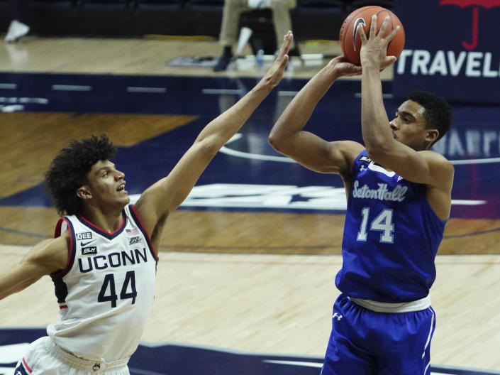 Seton Hall guard Jared Rhoden (14) shoots and scores over Connecticut guard Andre Jackson (44) during the second half of an NCAA college basketball game, Saturday, Feb. 6, 2021, at Harry A. Gampel Pavilion in Storrs, Conn. (David Butler II/Pool Photo via AP)