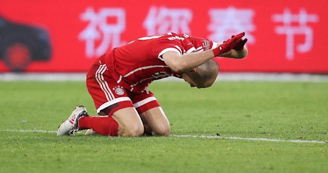 Bayern Munich's midfielder Arjen Robben reacts to a missed penalty (AFP Photo/Ronny Hartmann)