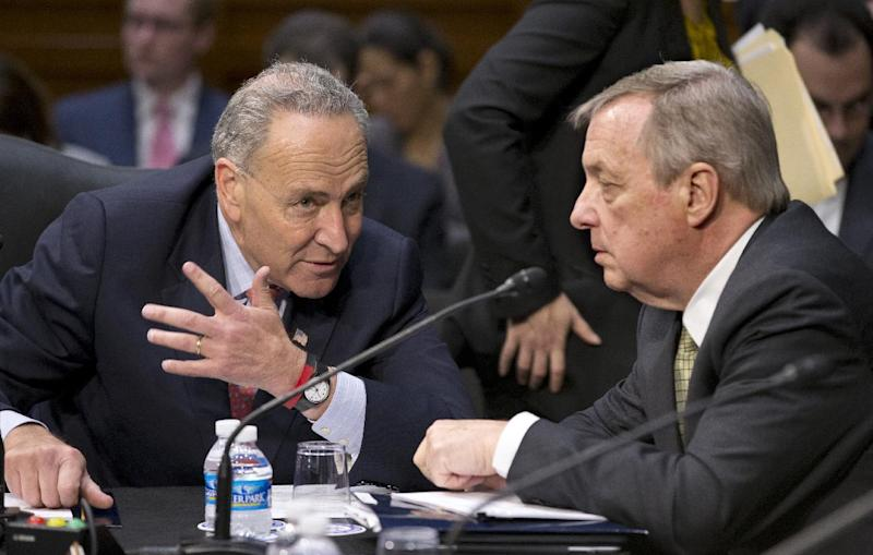 Senate Judiciary Committee members Sen. Chuck Schumer, D-N.Y., left, and Sen. Richard Durbin, D-Ill. confer on Capitol Hill in Washington, Monday, May 20, 2013, as the committee assembled to work on a landmark immigration bill to secure the border and offer citizenship to millions. The panel is aiming to pass the legislation out of committee this week, setting up a high-stakes debate on the Senate floor.  (AP Photo/J. Scott Applewhite)