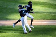 Chicago White Sox's Billy Hamilton (0) high-fives third base coach Joe McEwing (47) after hitting a home run during the fourth inning of the second baseball game of a doubleheader against the Baltimore Orioles, Saturday, May 29, 2021, in Chicago. (AP Photo/Matt Marton)