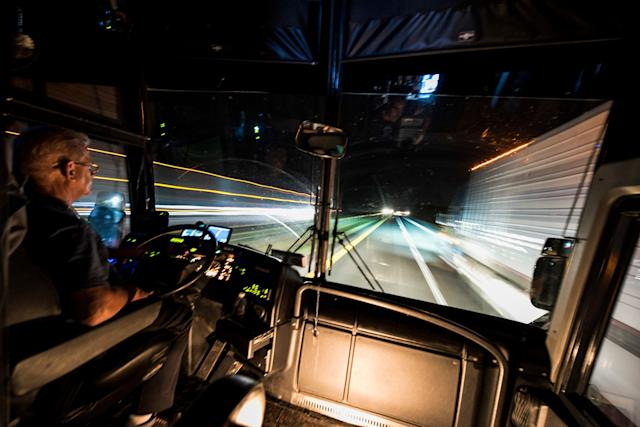 Bus driver Bobby Jensen does some late-night driving on theway to Oxford.