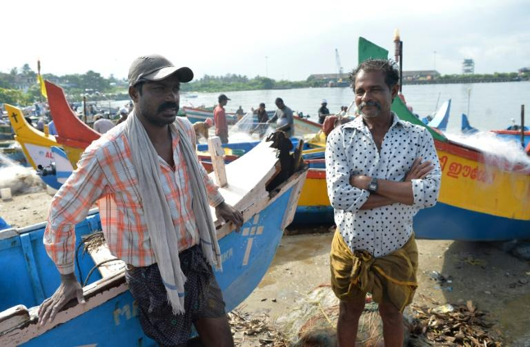 Michael Solomon (R), 56, and Manoj Francis, 40, fishermen from Kollam who took part in recent rescue operations in the floods