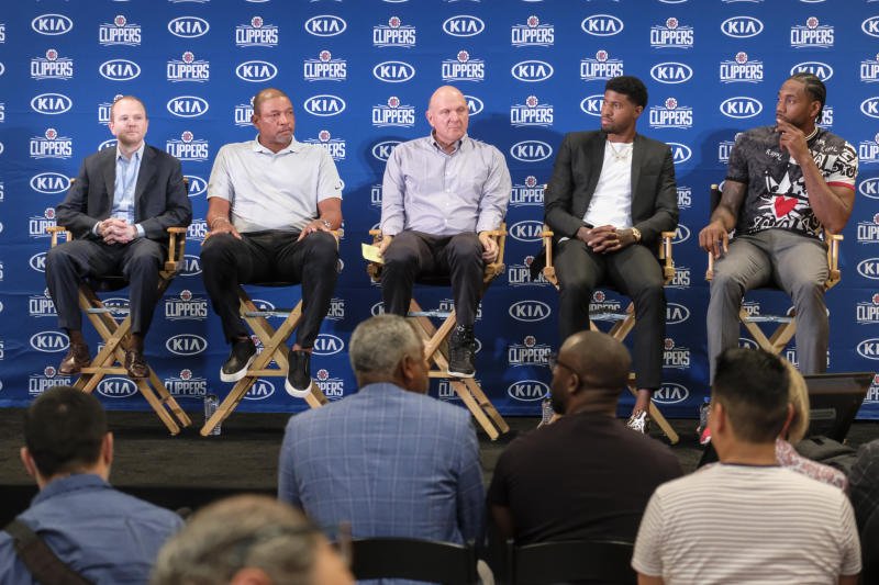 From left, Los Angeles Clippers President of Basketball Operations Lawrence Frank, head coach Doc Rivers, team chairman Steve Ballmer, Paul George and Kawhi Leonard attend a press conference  in Los Angeles, Wednesday, July 24, 2019. Nearly three weeks after the native Southern California superstars shook up the NBA by teaming up with the Los Angeles Clippers, the dynamic duo makes its first public appearance. (AP Photo/Ringo H.W. Chiu)