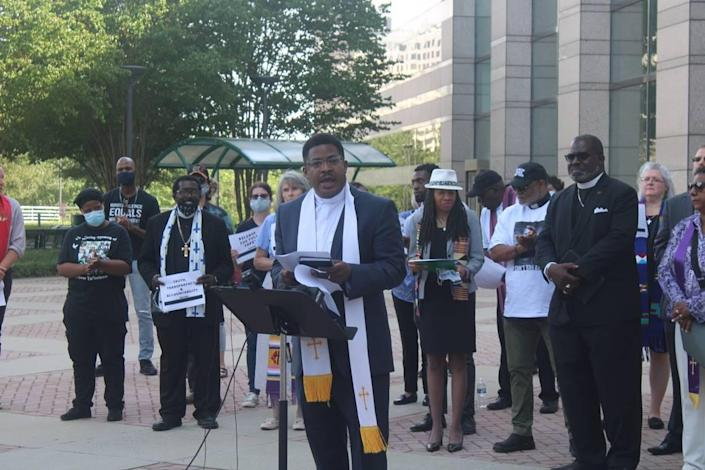 Rev. Paul McAllister speaking at the Andrew Brown Jr. rally, which took place in front of the Charlotte-Mecklenburg Government Center on Tuesday.