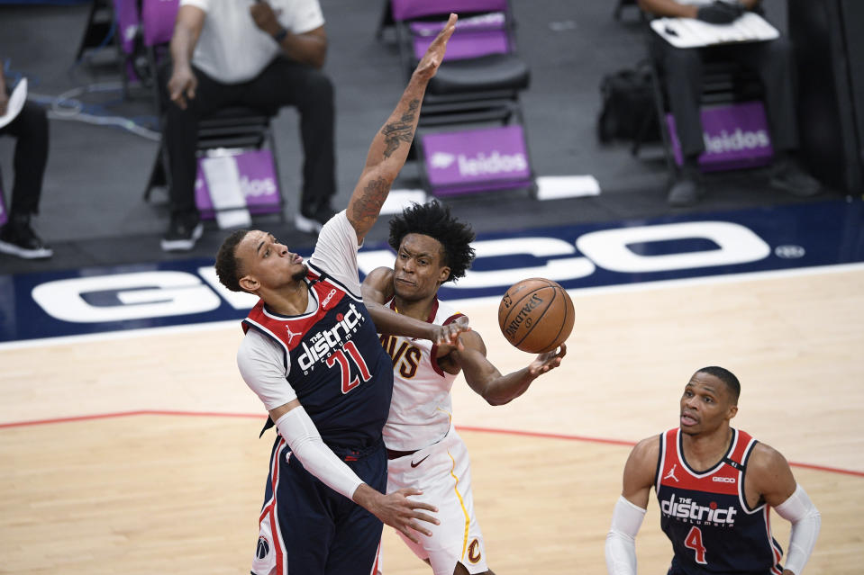 Cleveland Cavaliers guard Collin Sexton, center, goes to the basket against Washington Wizards center Daniel Gafford (21) during the second half of an NBA basketball game, Friday, May 14, 2021, in Washington. Wizards guard Russell Westbrook is at right. (AP Photo/Nick Wass)