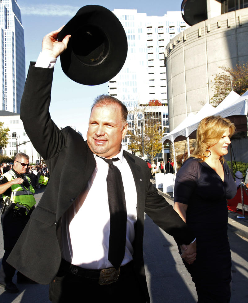 Garth Brooks and Trisha Yearwood attend the Country Music Hall of Fame Inductions on Sunday, Oct. 21, 2012 in Nashville, Tenn. (Photo by Wade Payne/Invision/AP)