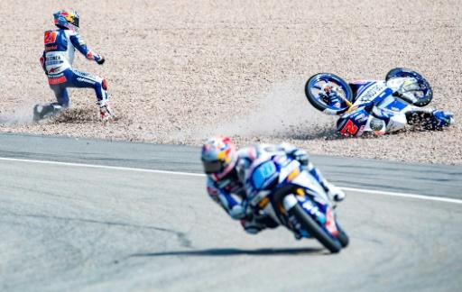 Moto3 Honda rider Fabio Di Giannantonio fell after running into the back of teammate Jorge Martin who stayed upright and won