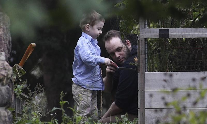 Joshua Boyle and his son Jonah play in the garden in Smiths Falls on Saturday.
