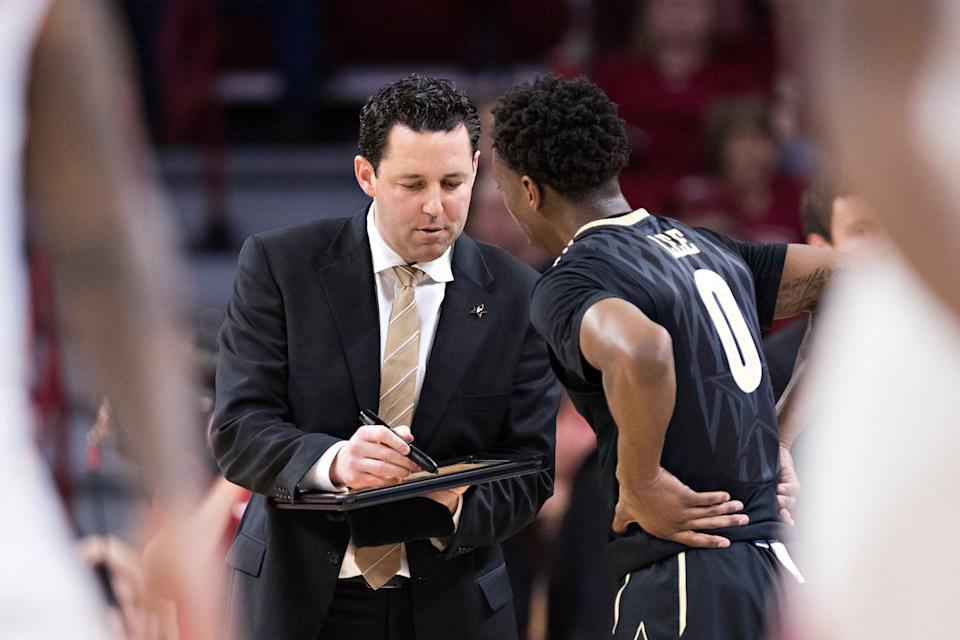 FAYETTEVILLE, AR - FEBRUARY 10:  Head Coach Bryce Drew talks with Saben Lee #0 of the Vanderbilt Commodores on the sidelines during a game against the Arkansas Razorbacks at Bud Walton Arena on February 10, 2018 in Fayetteville, Arkansas.  The Razorbacks defeated the Commodores 72-54.  (Photo by Wesley Hitt/Getty Images)